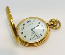 A gold plated half hunter pocket watch, the white enamelled dial with subsidiary second dial, marked