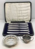 A cased set of hallmarked silver handled knives, a silver dish and SCM two handled salt