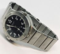 """A stainless steel """"Survivor"""" watch with built in compass to reverse"""