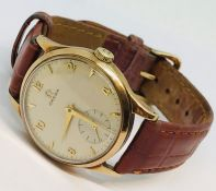 A gentleman's 9ct gold Omega mechanical wristwatch with subsidiary dial. Original 9ct gold buckle.