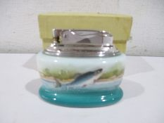 A boxed Minton porcelain cased Ronson table lighter, painted with leaping salmon signed R Scott