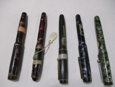 A collection of five fountain pens. Includes one Mentmore Autoflow, two Summit and two Eversharp.