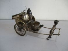 A novelty Chinese silver condiment set in the form of a rickshaw