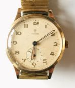 A 9ct gold Tudor (Rolex) gentleman's wristwatch with subsidiary second dial. Inscription to reverse.