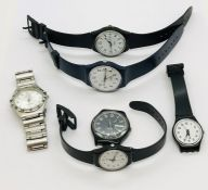 A collection of watches, mainly Swatch