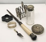 A hallmarked silver bookmark in the form of a trowel, silver lidded sugar caster, silver lid along