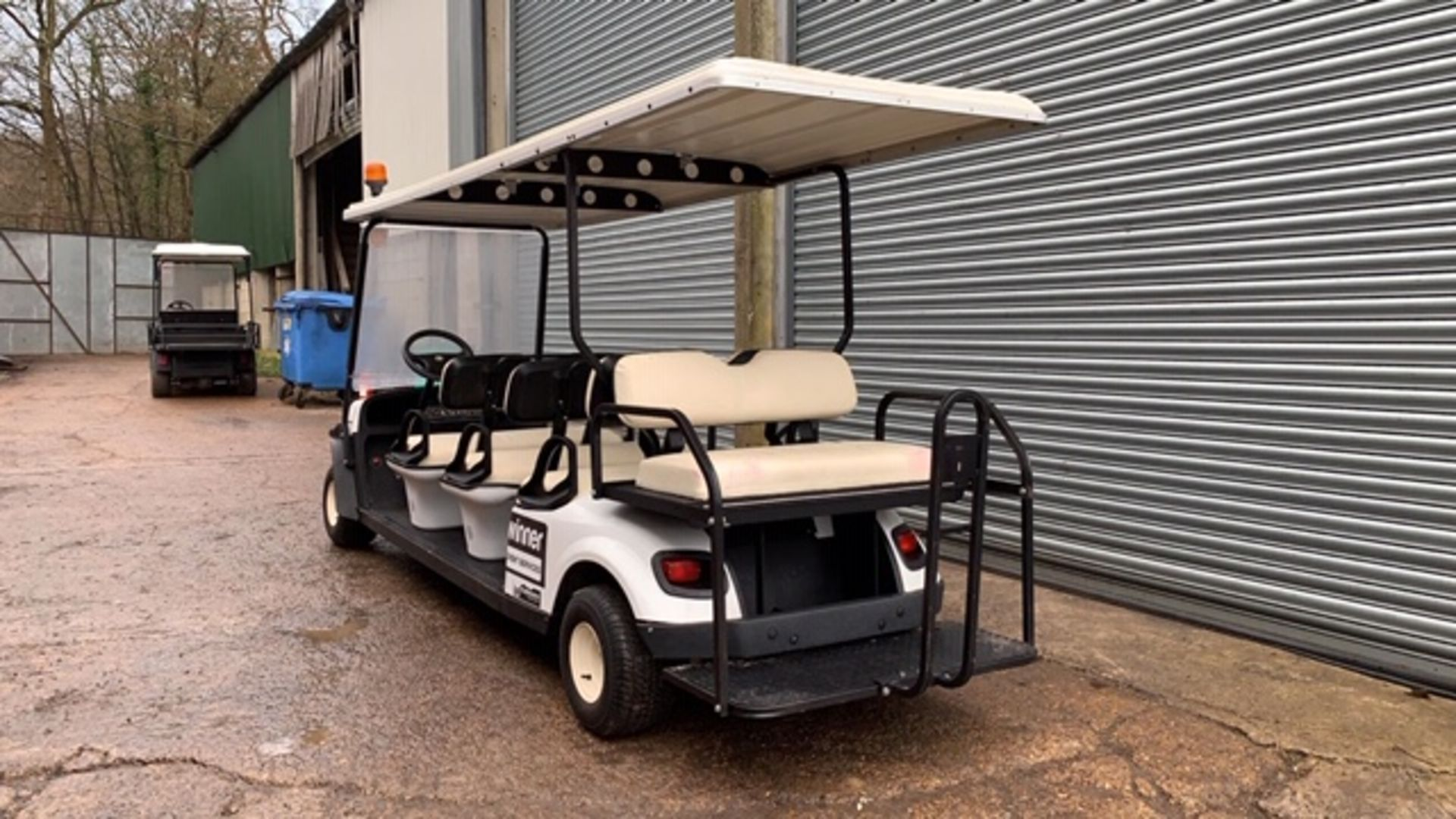 Lot 3 - CUSHMAN EZGO SHUTTLE 8 PETROL ENGINED 8 SEATER GOLF / EVENTS BUGGY. YEAR 2017 BUILD. DIRECT FROM