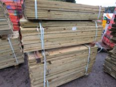 LARGE STACK OF FEATHER EDGE FENCE CLADDING TIMBER 1.35MX10CM APPROX.