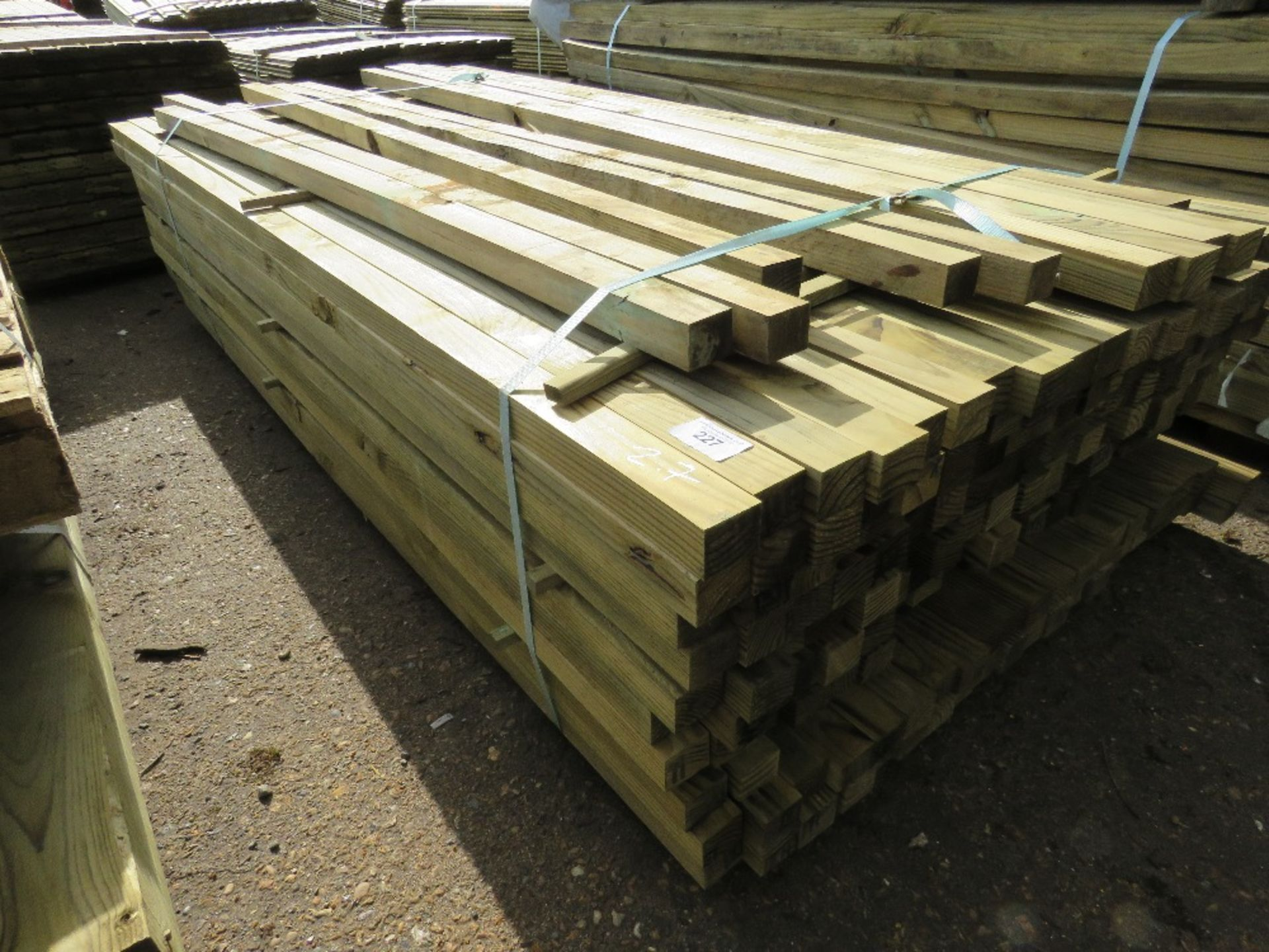 Lot 227 - Pack of 2.7m length timber posts, 55mm x 45mm approx. 220no. approx in total