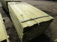 Pack of profiled fence cladding timber, 1.74m length, 10cm x 5mm approx.