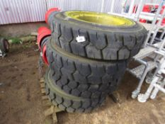 4no. Solid machine wheels and tyres, size 10.00-20