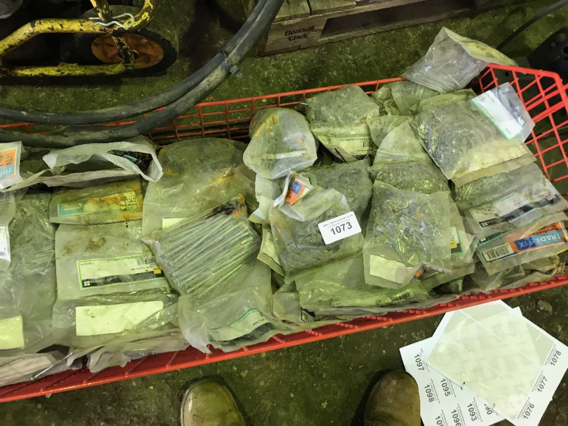 Lot 1073 - Mesh stillage of nails in bags