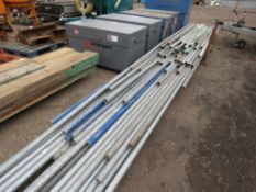 STILLAGE CONTAINING ASSORTED LENGTH SCAFFOLD POLES UP TO 20FT LENGTH