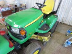 JOHN DEERE X740 2WD RIDE ON MOWER. WHEN TESTED WAS SEEN TO RUN, DRIVE, STEER AND MOWERS TURNED. 1416