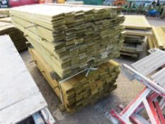 2 X PACKS OF CLADDING TIMBER 1.74M X 9.5CM WIDE APPROX.