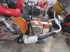 STIHL TS400 PETROL SAW PUS A SAW TROLLEY.