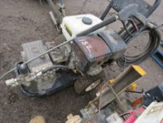 PETROL ENGINED HIGH PRESSURE CLEANER WITH LANCE AND HOSE. VENDOR'S COMMENTS: RUNS AND WASHES BUT SPA