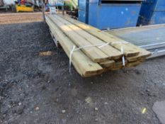 PALLET CONTAINING APPROXIMATELY 23 LENGTHS OF PROFILED TIMBER RAILS. 14CM X 3.5CM X 10FT APPROX.