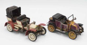 Zwei Schuco Modellautos
