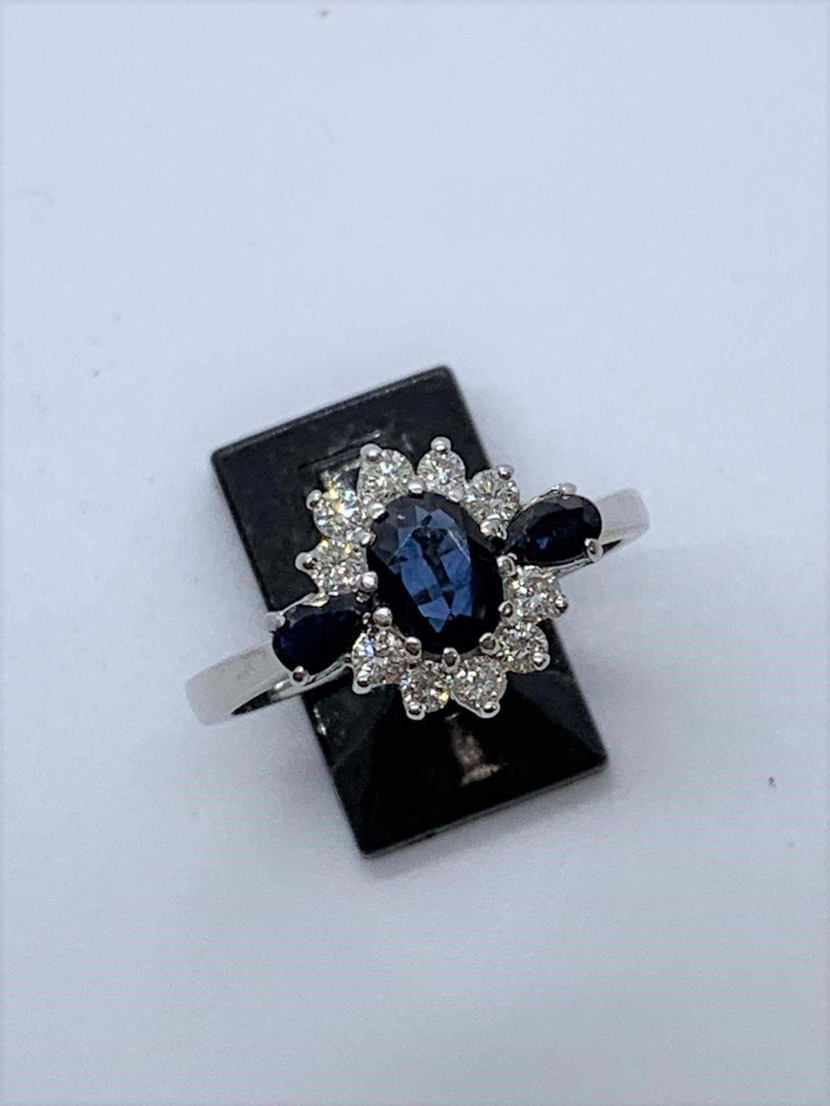 Lot 9 - 18ct white gold sapphire & diamond ring