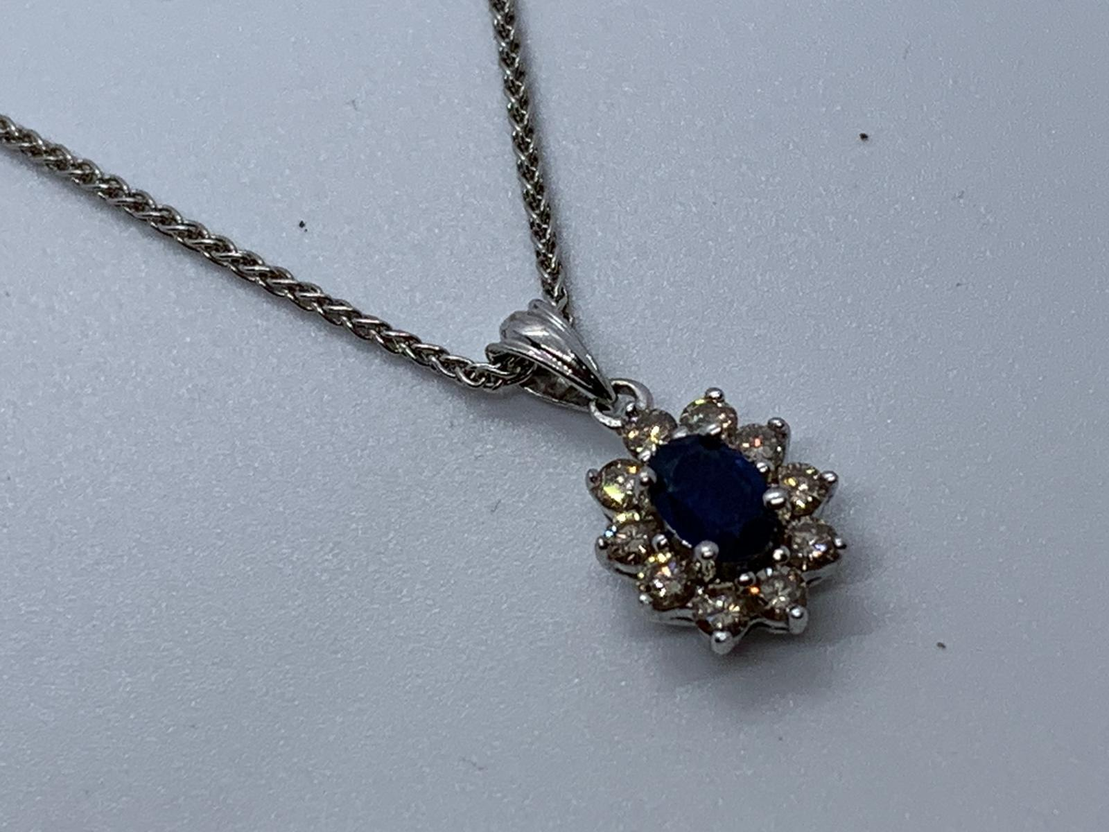 Lot 17 - 18ct white gold sapphire & diamond pendant and chain