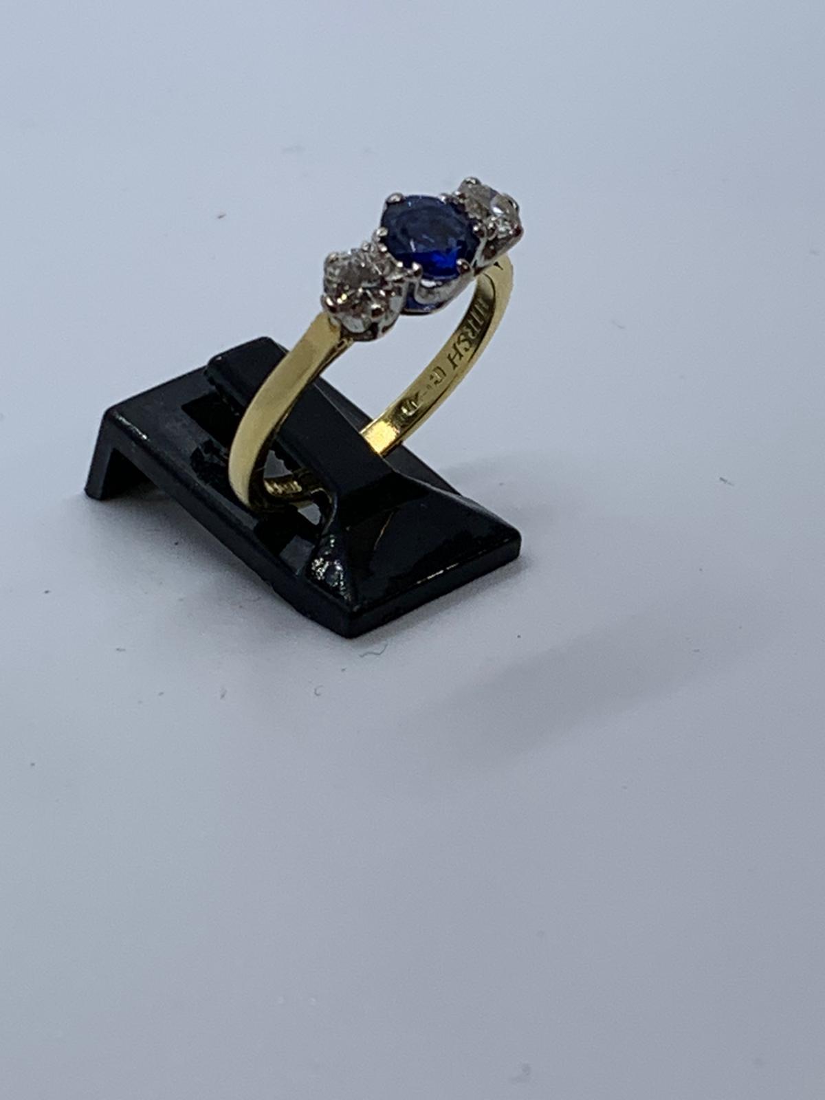 Lot 12 - 8ct gold sapphire & diamond ring