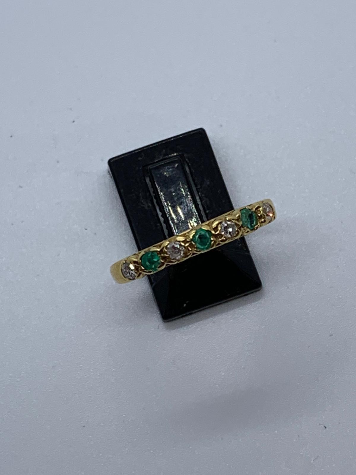 Lot 25 - 18ct gold emerald & diamond ring
