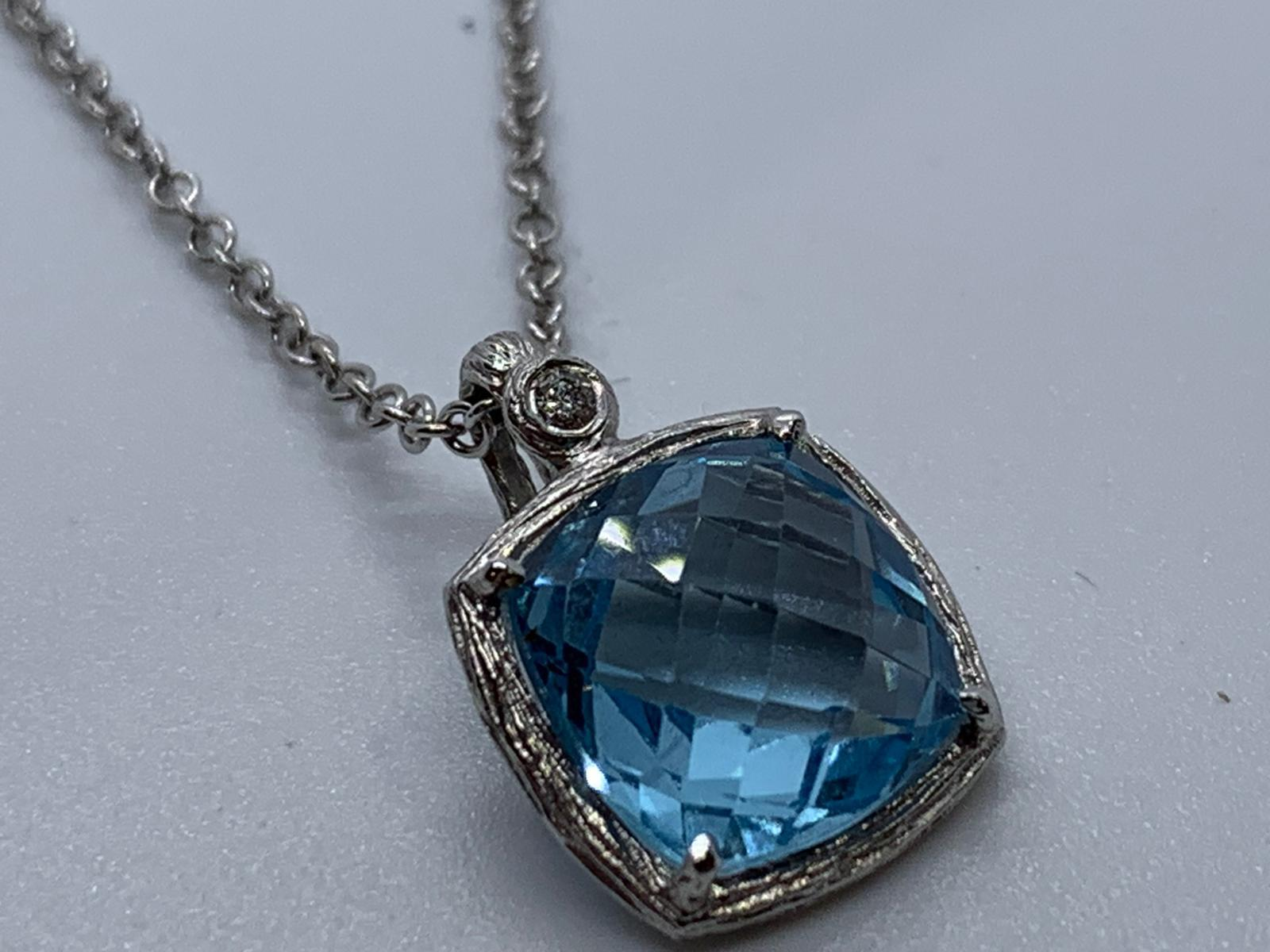 Lot 16 - 18ct white gold topaz & diamond pendant and chain