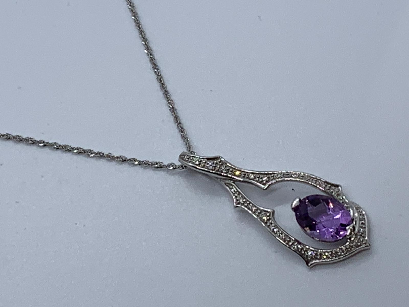 Lot 20 - 9ct white gold amethyst & diamond pendant & chain