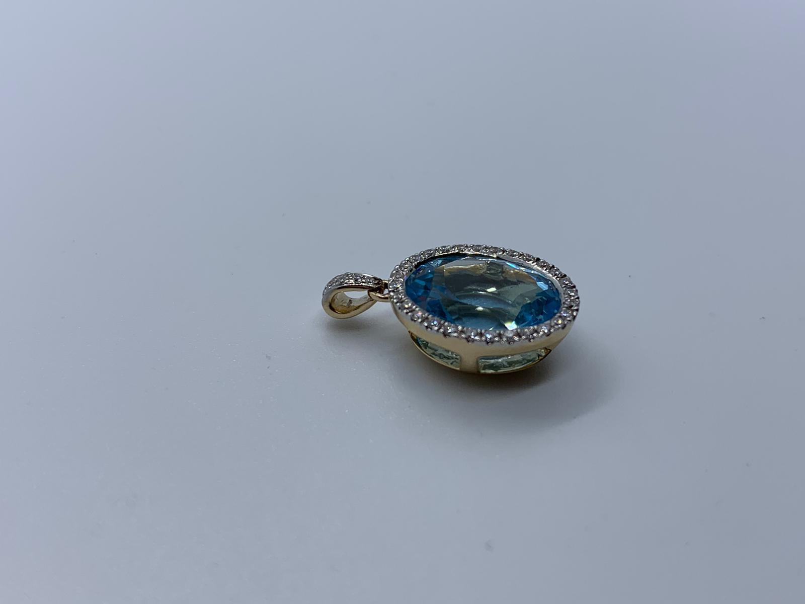 Lot 18 - 9ct gold blue topaz & diamond pendant