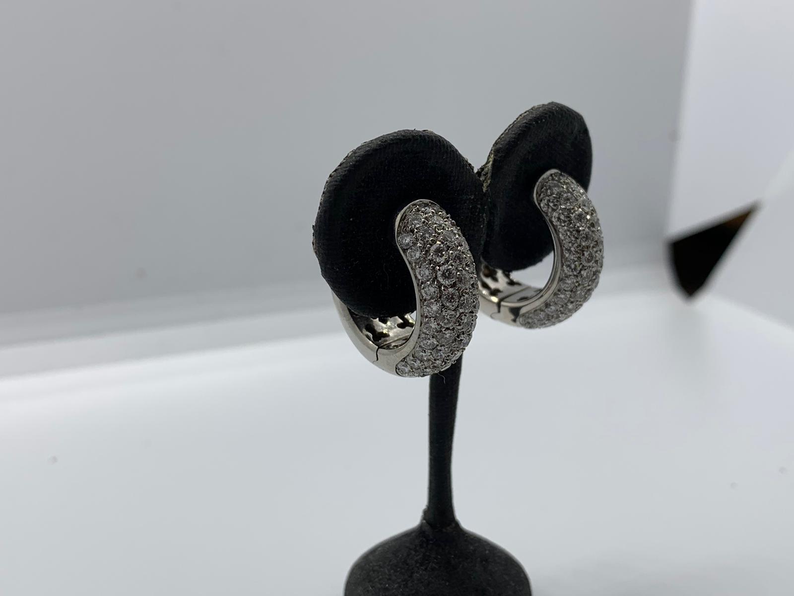 Lot 1 - 18ct white gold diamond hoop earrings