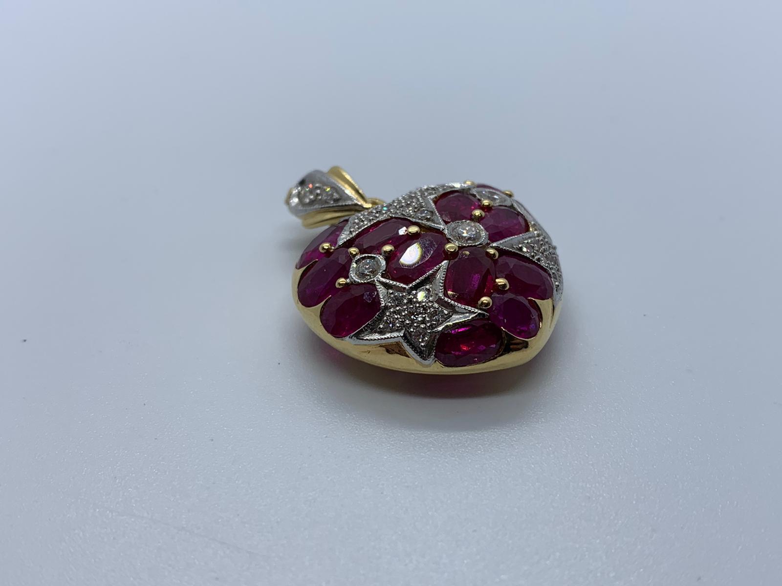 Lot 23 - 18ct gold ruby & diamond heart pendant