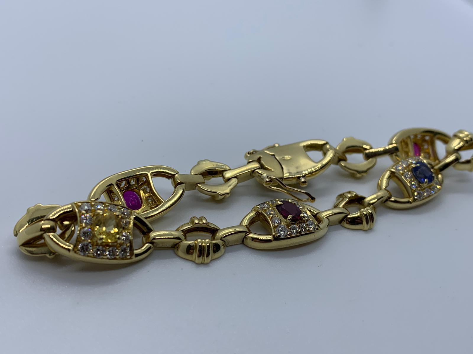 Lot 4 - 18ct gold, diamond, ruby, blue & yellow sapphire bracelet