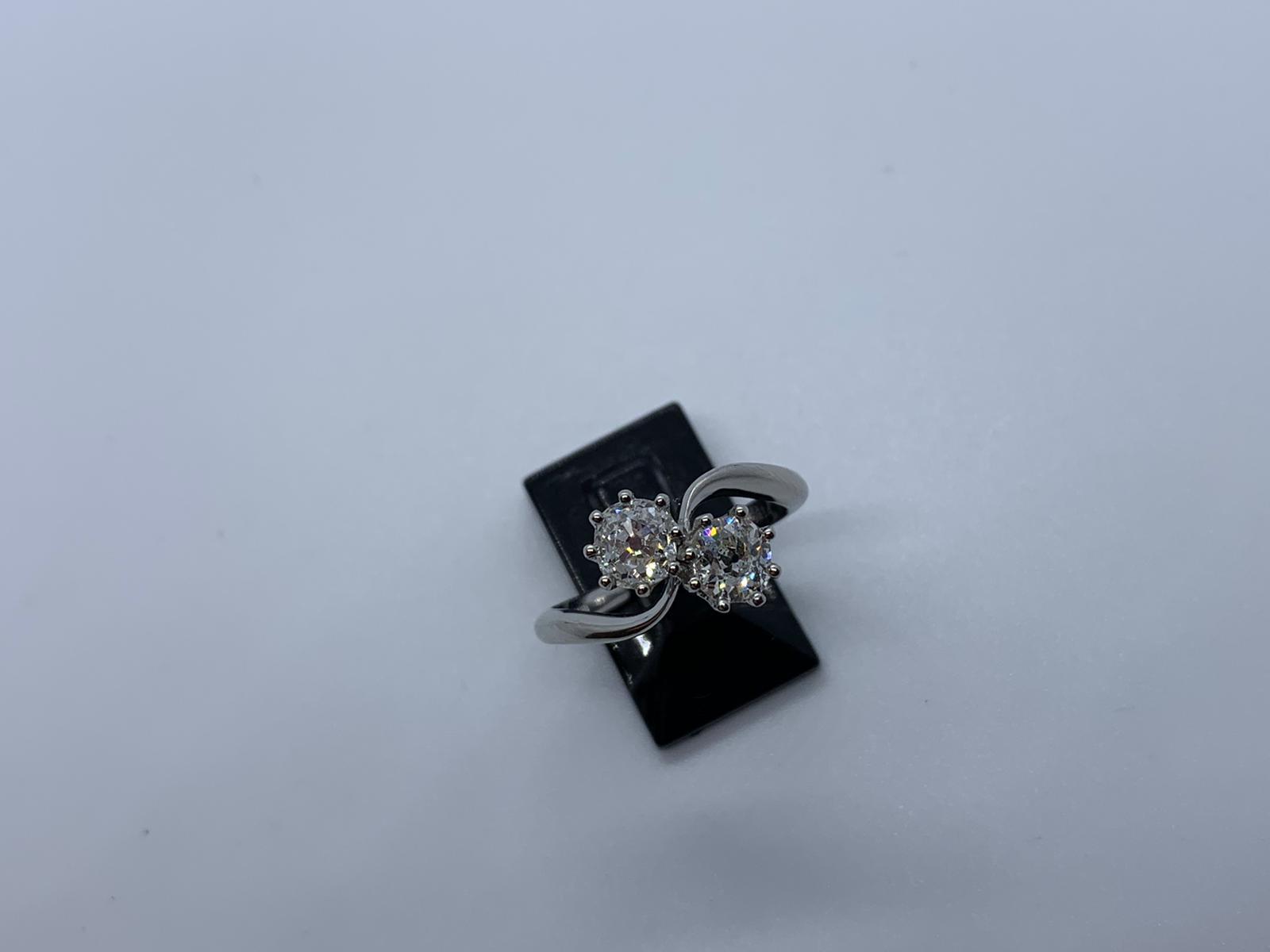 Lot 19 - Platinum 2 stone diamond ring