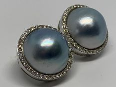 9ct white gold, blue mabe pearl and diamond earrings