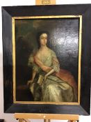 18th century Continental school, oil on stretched canvasof a seated lady, unsigned with paper label