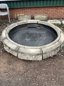 A sectional reconstituted stone fountain base with modern central well. approx 2m diameter.
