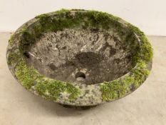 A small circular planter