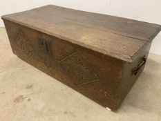 Small oak coffer with carving to front panel. W:85cm x D:40cm x H:28cm