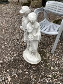 A reconstituted stone figural group of two Breton children. 92cm(h)