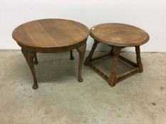 Two oak circular side tables. 60cm(d) and 51cm(d)
