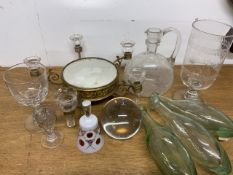 Glassware to include green glass bottles a mirrored centre piece, decanter and drinking vessels.