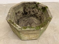 An octagonal concrete planter