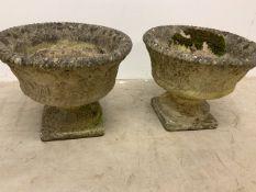 A pair of circular concrete planters on plinths W:40cm x D:40cm x H:32cm