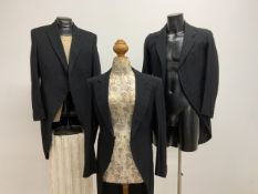 Three vintage wool frock coats. Various sizes.