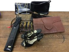 A collection of vintage evening bags to include crocodile and snakeskin examples, a vintage umbrella