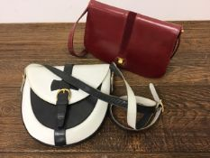 A quality 1980s soft leather bag by S.Launer & co bag makers to the Queen, a 1980s saddle bag by
