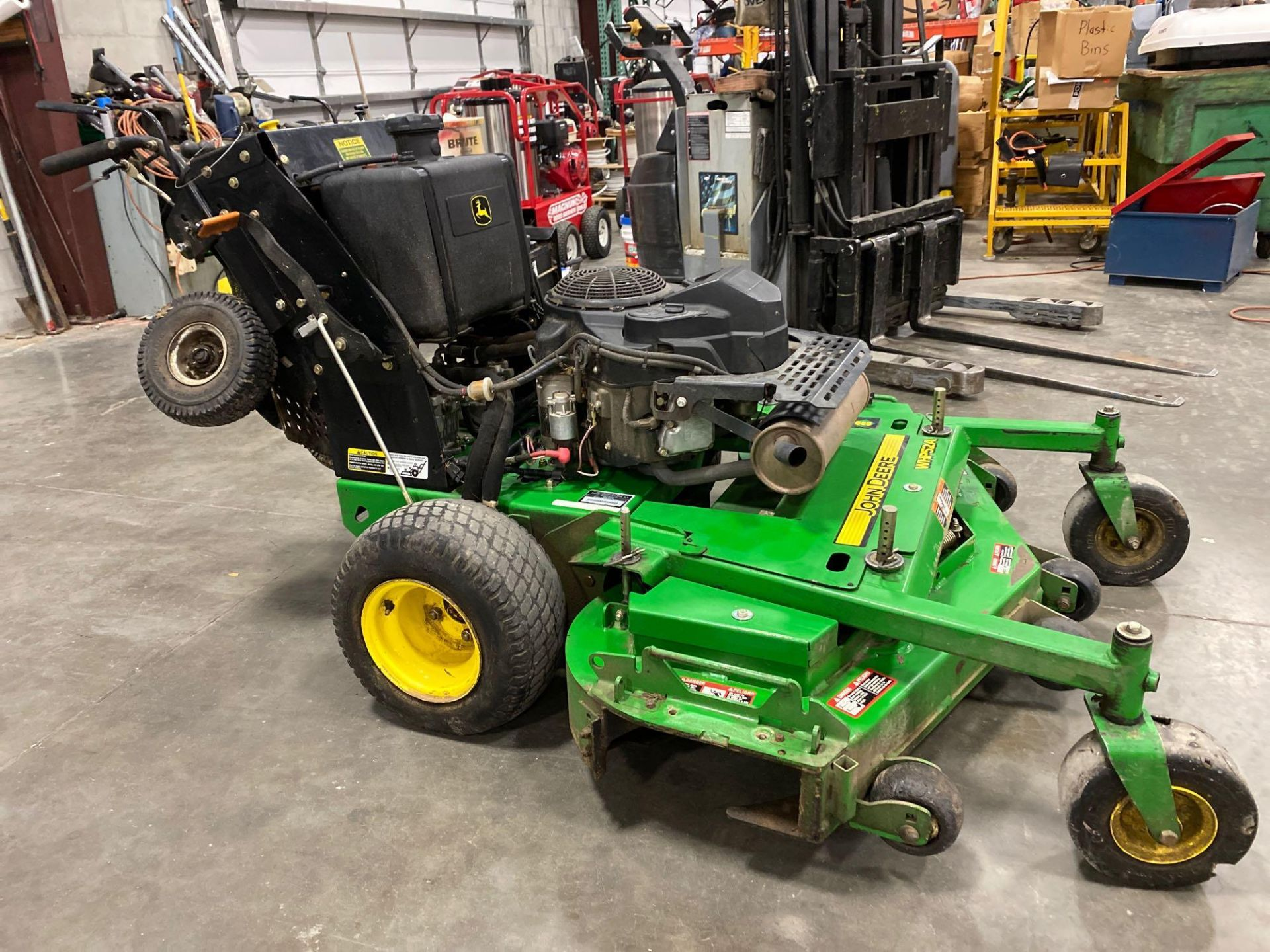 """Lot 31B - 2016 JOHN DEERE WHP52A STAND ON MOWER, 1,362 HOURS SHOWING, 52"""" DECK, GAS POWERED, RUNS AND OPERATES"""