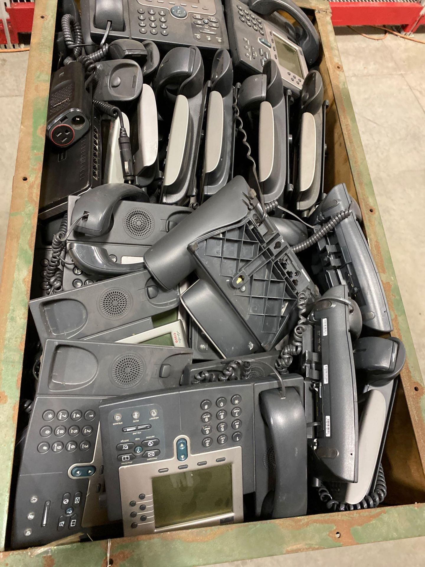 Lot 142 - TWO CRATES OF CISCO IP PHONES