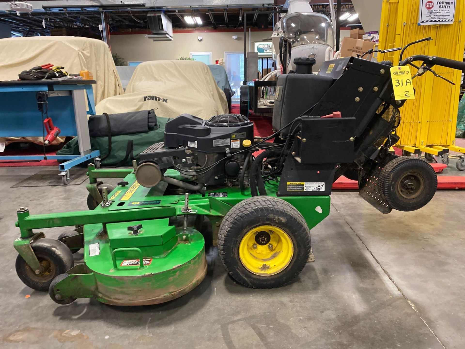 """Lot 31A - 2016 JOHN DEERE WHP52A STAND ON MOWER, 1,028 HOURS SHOWING, 52"""" DECK, GAS POWERED, RUNS AND OPERATES"""